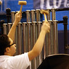 ROBERT LEBZELTER / Star Beacon<br /> CONNEAUT MIDDLE School student Rashad Al-Araibi<br /> plays the chimes during the concert celebrating a century of music.