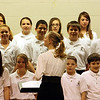 "ROBERT LEBZELTER / Star Beacon<br /> MEGAN KALOSKY directs the Conneaut Middle School choir during the ""100 Years of Music"" Thursday at Conneaut High School."