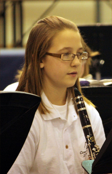 ROBERT LEBZELTER / Star Beacon<br /> SEVENTH-GRADER Pearl Sharp plays clarinet during the concert celebrating a century of music.