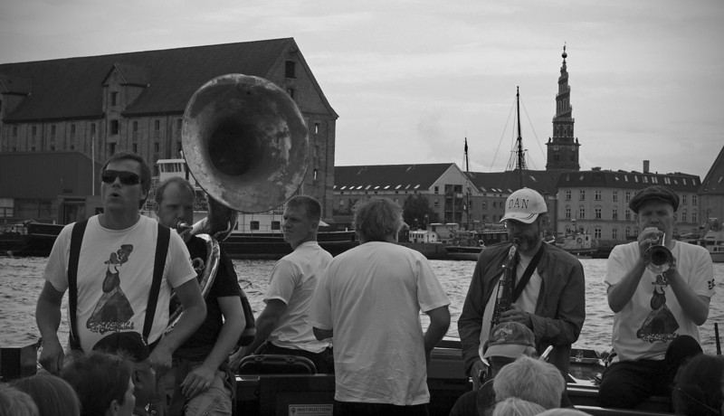 Classic Copenhagen, classic Jazz.<br /> Harbour parade with the Orion Brass Band.<br /> Old warehouses and the spiral spire of Our Saviours Church. You may walk all the way to the top.