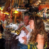 "Duet.<br /> Lissette with trumpeter at ""Tværen"", Rosengården, Copenhagen, Denmark.<br /> Photo painted with digital smeary oil brush in Corel Painter + texture layers."