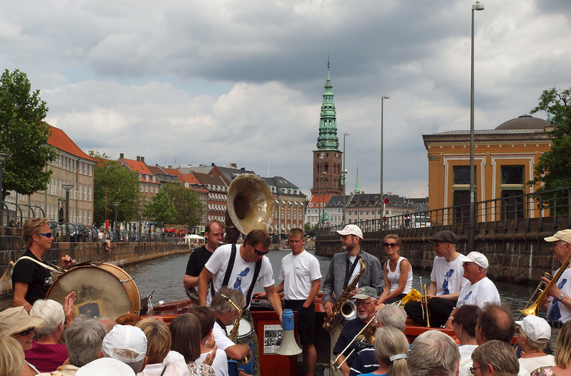 In the heart of Copenhagen.<br /> Harbour parade with the Orion Brass Band.<br /> Saint Nicholas Church in the background.