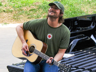 Eric Church on the tailgate of a Chevy Truck in Nashville - 2007