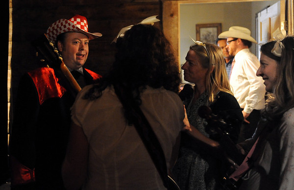 "Jimmy Martin, left, tells one of his stories backstage at the barn.<br /> Bertolin Barn, north of Longmont, is one of the only venues to see country music in Boulder County.<br /> For a video of the music and more photos, go to  <a href=""http://www.dailycamera.com"">http://www.dailycamera.com</a><br /> Cliff Grassmick/ April 30, 2011"