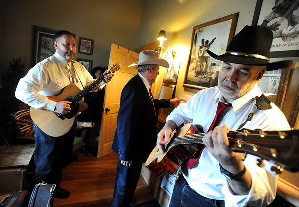 "Jim Deeming, left, and other musicians warm up before performing.<br /> Bertolin Barn, north of Longmont, is one of the only venues to see country music in Boulder County.<br /> For a video of the music and more photos, go to  <a href=""http://www.dailycamera.com"">http://www.dailycamera.com</a><br /> Cliff Grassmick/ April 30, 2011"