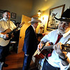 """Jim Deeming, left, and other musicians warm up before performing.<br /> Bertolin Barn, north of Longmont, is one of the only venues to see country music in Boulder County.<br /> For a video of the music and more photos, go to  <a href=""""http://www.dailycamera.com"""">http://www.dailycamera.com</a><br /> Cliff Grassmick/ April 30, 2011"""