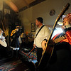 """Jimmy Martin, right, takes a drink from a flask, as other musicians get ready back stage.<br /> Bertolin Barn, north of Longmont, is one of the only venues to see country music in Boulder County.<br /> For a video of the music and more photos, go to  <a href=""""http://www.dailycamera.com"""">http://www.dailycamera.com</a><br /> Cliff Grassmick/ April 30, 2011"""