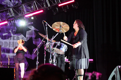 Rosie O'Donnell joined the band for a little drum action.