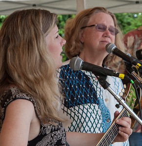 Dar Williams and Holly Near on the Rainbow Stage at the Clearwater Festival 2014.