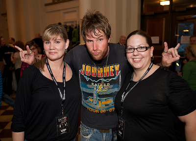 Kristy Wilson and Katie Shiveley of Loveland pose with Mike Sanchez who opened for Daughtry at Cincinnati Music Hall on Tuesday