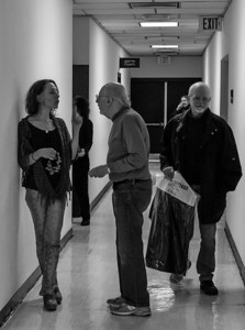 Bethany Yarrow and Peter Yarrow having a talk in the hall ouside the green room.  Michael Mark coming in to get changed.