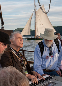 Tom Paxton and David Amram on the Mystic Whaler with the Clearwater sailing past.