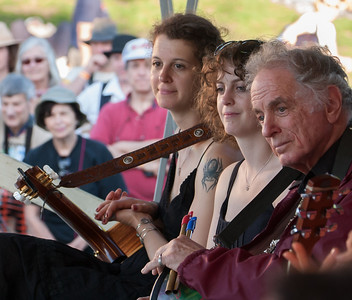 Alana Amram, Adira Amram and David Amram in a pensive moment on the Rainbow Stage for the Generations Set at the 2011 Hudson River Sloop Clearwater Festival in Croton, NY.