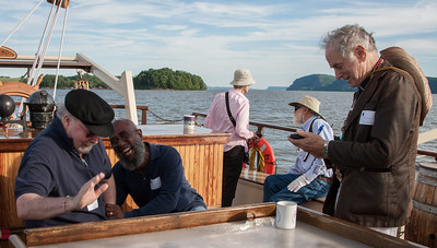 Tom Paxton, Josh White Jr. and David Amram sharing a laugh on the Mystic Whaler, June 2014.
