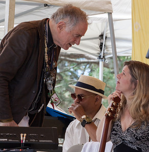 David Amram talking with Dar Williams.  That's Guy Davis on the harmonica.  This is on the Rainbow Stage just before their set at the 2014 Clearwater festival.