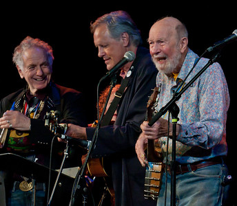 David Amram, Tom Chapin and Pete Seeger at Tarrytown NY's Music Hall for a Hudson River Sloop Clearwater Earth Day concert in 2012.  That's Lisa Gutkin from the Klezmatic's behind Tom.