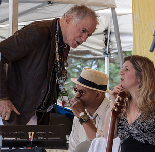 David Amram and Dar Williams having a conversation on the Rainbow Stage before their set at the 2014 Clearwater Festival.  That's Guy Davis on the harmonica in back.