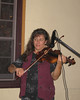 Fiddling at McCoole's with DayBreak. (Photo by Pamela West).