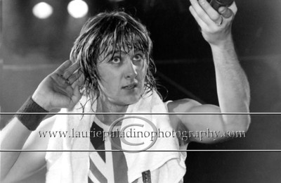 DefLeppard_1003 Lead singer of Def Leppard Joe Elliot performing live in concert.