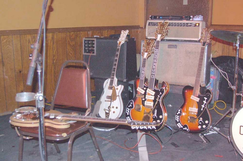 Wacky guitars.  The White Penguin is not original, hence not worth $100,000.