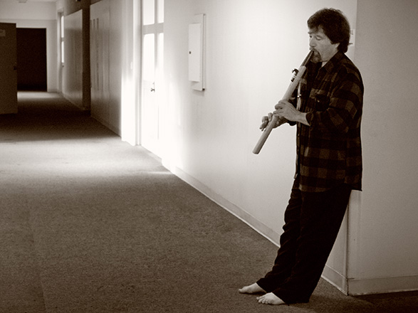 Bill Leyden rehearses with Native American-style flute by John Stillwell.  Photo: Hugh Milne.