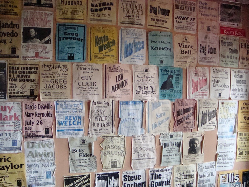 Several shots of posters on walls inside The Blue Door.  This is wall to the right as you enter.