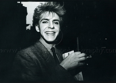 DuranDuran_lp_1003 Keyboard player Nick Rhodes of the English pop group Duran Duran signs autographs in Greenwich Village, New York City streets following a press party for Duran Duran in 1984