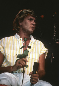 DuranDuran_lp_1015 Lead singer Simon LeBon of English pop group Duran Duran performs live in concert in New York City 1984. He's holding a red rose given to him by a fan during the performance.