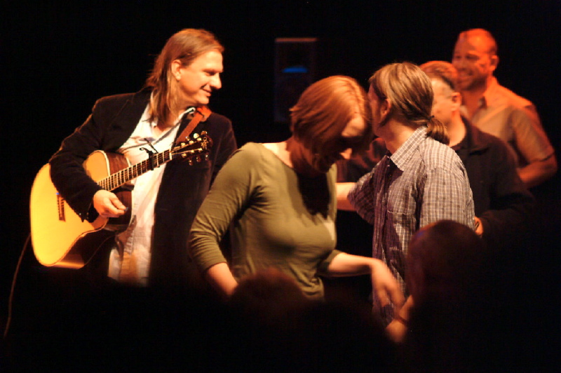 Ellis with German fans who responded after he asked if anyone in the audience had a guitar pick he could borrow. Katrin Hirseland, seen in green top and red hair, was the first Ellis Paul fan to see him on two continents! Belaqua Theater.  Wasserburg, Germany. May 24, 2006.