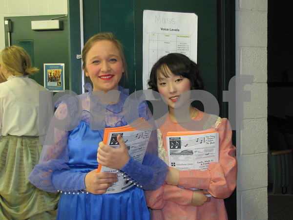 Mackenzie Scacci and Yeon ju Kim, performers in the musical, were handing out programs before the production.