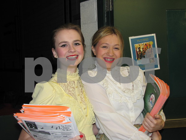 Performers Alexis Perrin and Alice Gaines handed out programs before the production of 'The Music Man'.
