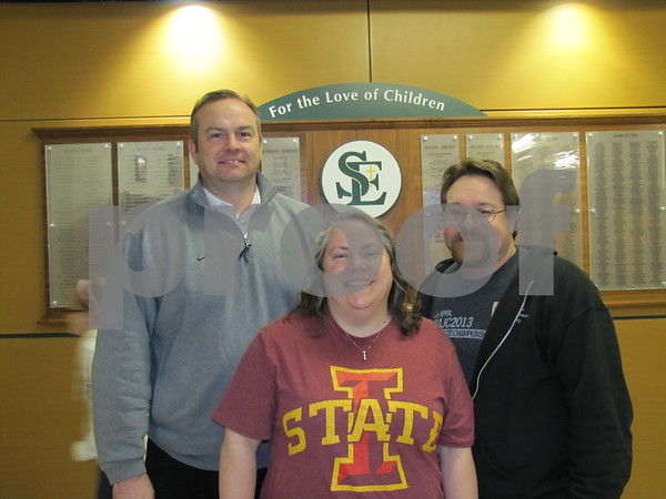 John Howard, principal of St. Edmond Catholic Schools, with Andrew and Betsy Duarte before the musical.