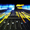 Unusual photograph  of an SSL Duality mixing board / console / desk in a recording studio with lights dimmed and no special effects, all the visual fx is done with zoom and use of flash on a long exposure