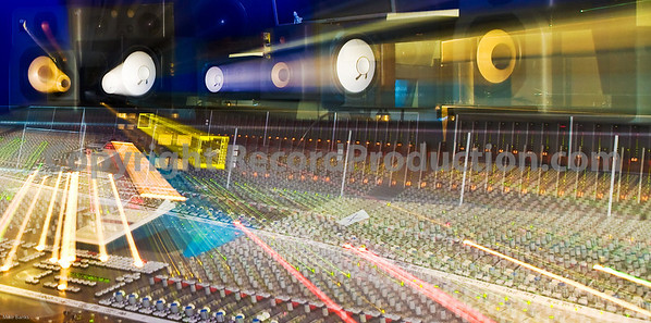 May delete this on, not quite right.  No Photoshop used, flash with long exposure zoomed out for effect  Hook End Manor Studios, featuring SSL J Series console - 96 channels big.