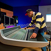 <b>This photo has model release and is available for commercial use.</b> Recording engineer or music producer mixing music on a mixing console in a recording studio