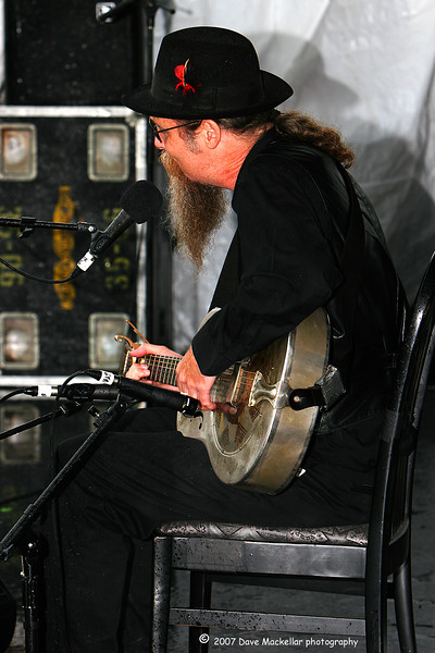 Doc MacLean with the National Steel guitar playing in the rain.<br /> This guy inspired everyone on the rainy Saturday.