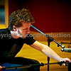 Danger.  Man at work!<br /> Nick, house engineer at Modern World Studios adjusts a microphone on guitar cab
