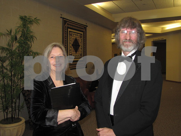 Roberta Bochtler and Alec Pendry of the Choral Society pose before the perfomance.