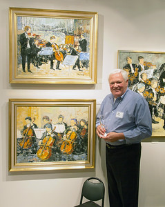 Joe Nolan, owner of Nolan-Rankin Galleries,  in front of the music-themed wall