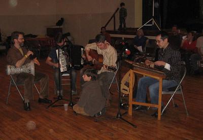 Skordalia (Music of the Greek islands and Asia Minor): Dean Lampros (sandouri), Joe Teja (oud, guitar), Mike Davis (percussion), Ken Hiatt (accordion). See zestygreekmusic.com