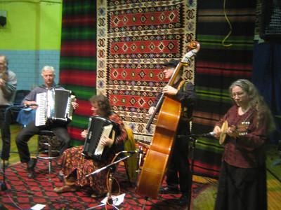 XOPO playing in the Kafana: Becky Ashenden (accordion), Chuck Corman (accordion, tambura), Miamon Miller (violin), Joe Blumenthal (bass), Barbara Blumenthal (tambura)