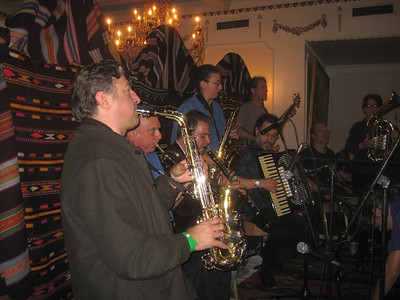 Kavala Brass Band playing Northern Greek music. Christos Govetas, Michael Ginsburg, Lefteris Bournias, Catherine Foster, Morgan Clark, Paul Brown, Jerry Kisslinger,  Matt Moran (not shown- playing tupan at front of stage), and it looks like Rachel MacFarlane at the end on baritone horn.