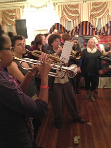 Catherine Foster, center, and two other truba (trumpet) players in her band.