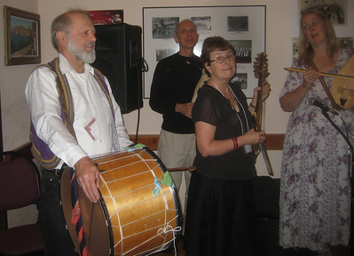 Rich Tucker, Jim Avera, Barbara Babin, and Joyce  of Da! Mozhem playing in the Kafana
