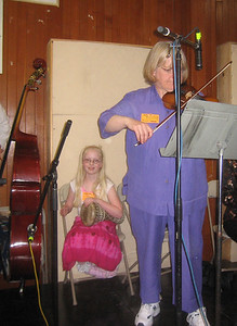 Linore plays dumbek as well as fiddle! Barbara on fiddle.  NEFFA 2006