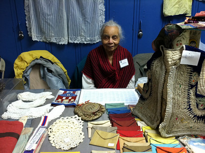 "Angela (""Angie"") Taylor at her booth selling her hand-sewn items.  Angie helped create the first NEFFA (1944) and has been a volunteer on the NEFFA committee ever since."