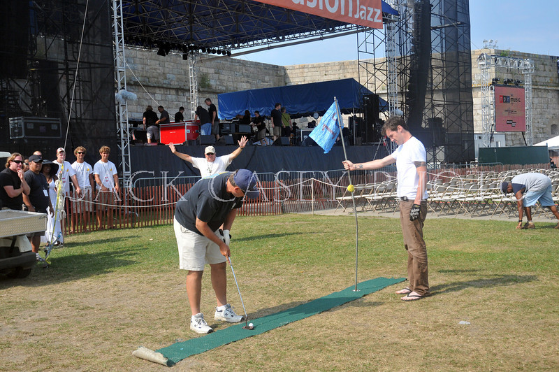 Jack Kane, Festival electrician, takes careful aim for the final shot for the prestigious America's Athletic Cup.