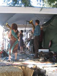 Brass Menazeri Balkan Brass Band. Baritone section: Rachel MacFarlane and Randy Trigg.