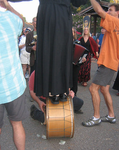 Dan continued drumming while a priest balanced on top.  See more photos of this on the church's website, under photo gallery of Glendi 2007.