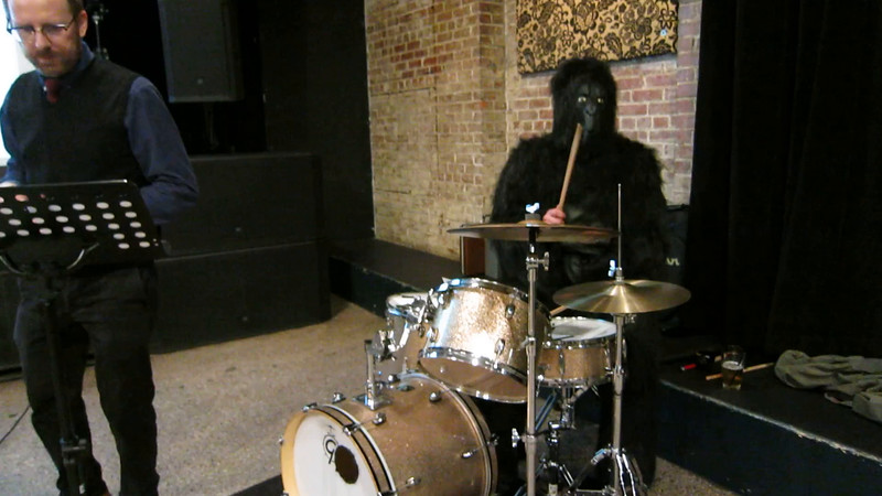 00aFavorite 20161010 (2050) Flash Chorus 6 of 9 - Noah dressed as a gorilla drumming for 'Crazy'